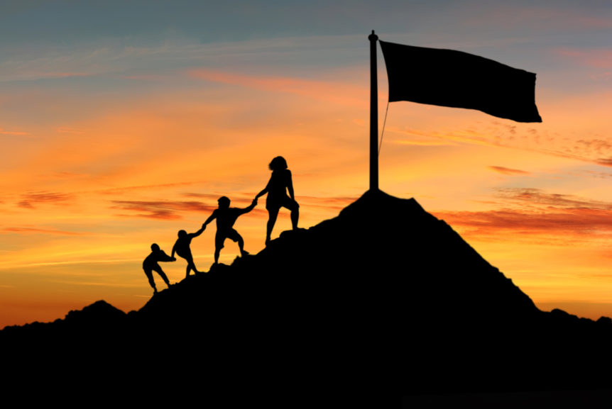 Image of people climbing a mountain to show how a Wealth building coach helping your reach your goals
